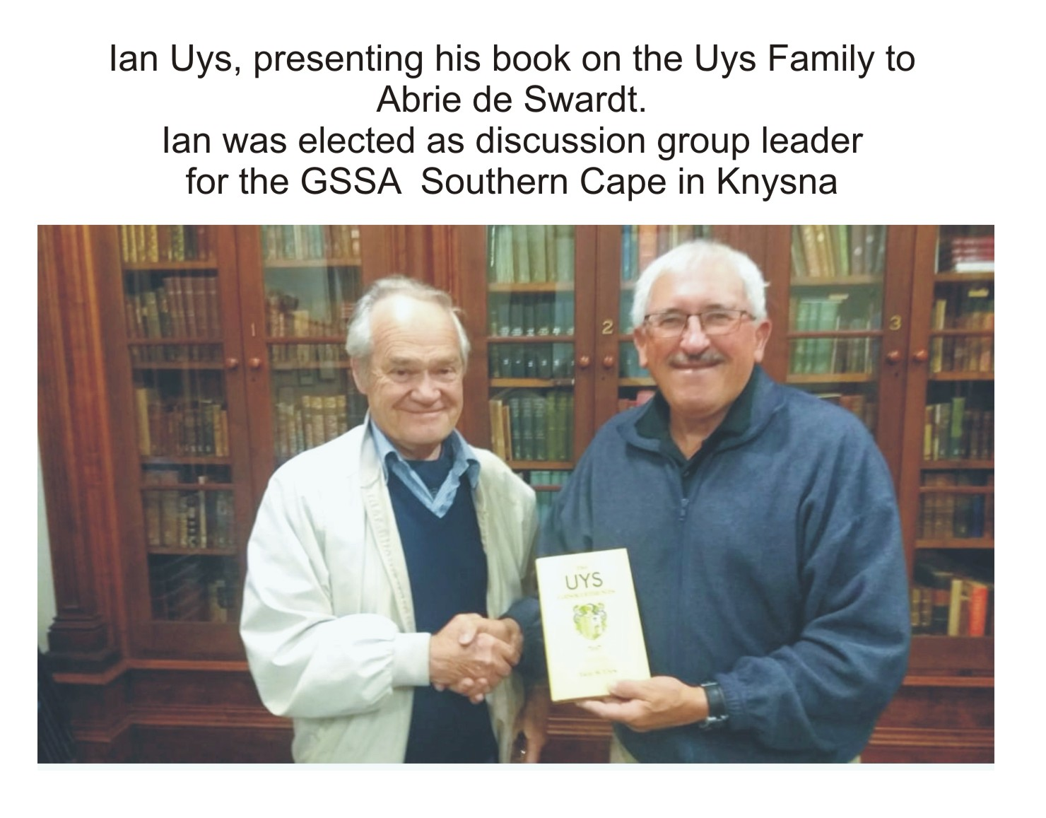Ian Uyspresents his book on the Uys family to Abrie de Swardt.Ian was elected as discussion group leader of the GSSA Southern Cape in Knysna